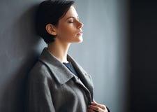 Ttired beautiful woman on dark background Stock Image