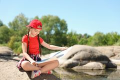 Little girl with map outdoors. Ttle girl with map outdoors. Summer camp royalty free stock photo