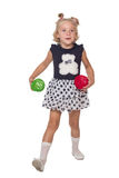 Ttle girl playing with colored balls Stock Photo