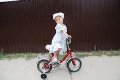Little stylish girl riding bike. Kid on bicycle. Child enjoying bike ride. Sport kids. Ttle stylish girl riding bike. Kid on bicycle. Child enjoying bike ride stock photos