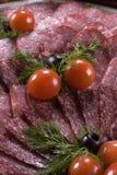 Ttomato, carne ahumada y diversas salchichas Imágenes de archivo libres de regalías