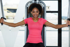 Аttractive fitness girl looking so happy working out Stock Image