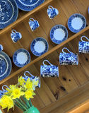 Ttraditional welsh kitchen dresser and china. Attractive traditional welsh kitchen dresser with blue and white china and daffodils Stock Image