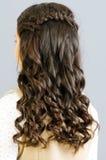 tätt hår upp kvinna Arkivfoto