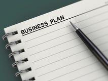 Título del plan empresarial, cuaderno, planificador, pluma Foto de archivo libre de regalías