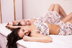 Ttwo beautiful women in the bed Stock Photography