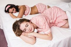 Ttwo beautiful women in the bed Stock Photos