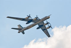Tu-95 strategic bomber. ZHUKOVSKY, RUSSIA - AUGUST 12: Tu-95 Bear strategic bomber flies during the celebration of the centenary of Russian Air Force on August Stock Image