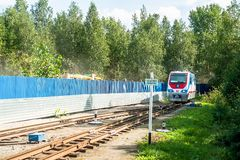 TU10-011 locomotive on Children railroad. Russia. Tyumen, Russia - August 22, 2013: Lakeside platform. Small Tyumen Children railroad. New TU10-011 locomotive on Stock Photos