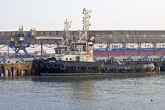 Tuapse sea port. The towboat near the oil terminal in the Tuapse sea port, Krasnodar region Stock Photography