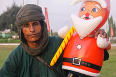 Tuareg with Blowup Santa. A Tuareg nomad poses with a blowup Santa doll in Accra, Ghana royalty free stock photos