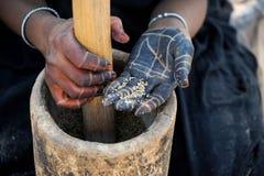 Tuareg hands. Hands of Tuareg woman preparing millet Stock Image