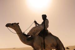 Tuareg with his camel. Near timbuktu Royalty Free Stock Photos