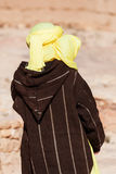 Tuareg. Man with traditional clothes seen from backside stock image