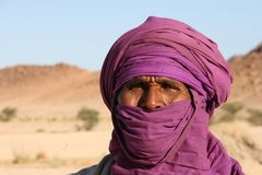 Tuareg portrait. Portrait of a old tuareg with a purple turban in south Algeria stock images
