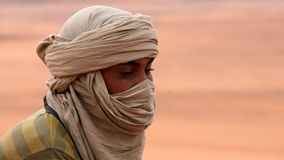 Tuareg portrait. Portrait of a tuareg with a brown turban in south Algerian Sahara Stock Photo