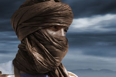Tuareg posing for a portrait. TIMBUKTU, MALI. Tuareg posing for a portrait in camp near Timbuktu royalty free stock photo