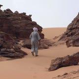 Tuareg walking in the desert. Ubari Desert, Libya - May 03, 2002 : Tuareg walking in the Sahara desert stock images