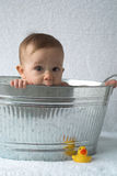 Tub Baby. Image of cute baby sitting in a galvanized tub stock photography