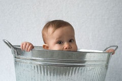 Tub Baby. Image of cute baby sitting in a galvanized tub royalty free stock image