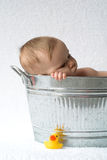 Tub Baby. Image of cute baby sitting in a galvanized tub royalty free stock photos