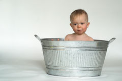 Tub Baby. Image of cute baby sitting in a galvanized tub Royalty Free Stock Photo