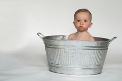 Tub Baby. Image of cute baby sitting in a galvanized tub Stock Images