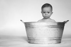 Tub Baby. Black and white image of cute baby sitting in a galvanized tub Royalty Free Stock Photography