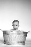 Tub Baby. Black and white image of cute baby sitting in a galvanized tub Stock Photo