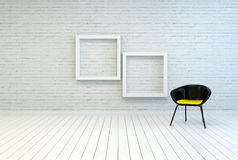 Tub chair alongside two empty picture frames Royalty Free Stock Images