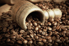 Tub with coffee beans. Tub with roasted coffee beans royalty free stock images