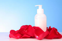 Tub with a  cream with red rose petals Royalty Free Stock Image