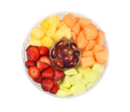Tub of Cut Fresh Fruit. A plastic tub of fresh cut fruit. Isolated on white fruits include, Strawberry, Pineapple, Apple, Cantaloupe, Honeydew Melon and Grapes royalty free stock photos
