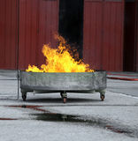 Tub full of flames and fire during the fire drill in the firehou Stock Images
