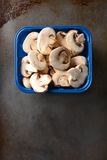 Tub of Sliced Mushrooms Royalty Free Stock Photos
