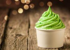 Tub of twirling creamy green Italian ice cream royalty free stock image