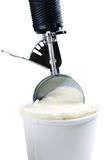Tub of vanilla ice cream with a scoop Royalty Free Stock Image