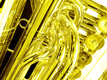 Tuba close up in gold. Liquid gold - a closeup picture of a tuba musical instrument.  Processed to golden monochrome for mood of fluid or liquid gold Royalty Free Stock Photography