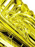 Tuba close up in gold. Liquid gold - a closeup picture of a tuba musical instrument.  Processed to golden monochrome for mood of fluid or liquid gold.  Vertical Royalty Free Stock Photo