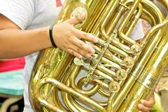 Tuba Handiwork. Close-up view of tuba player depicting hands  and valves Stock Photos