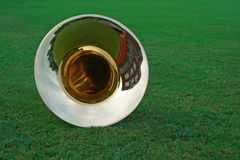 Tuba lying on the grass Royalty Free Stock Image