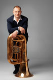Tuba Player. Portrait  of a young tubaist with his instrument Stock Images