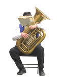 Tuba player isolated. Man playing the tuba while sitting, his face hidden by the sheet music.  Isolated on white Royalty Free Stock Image
