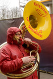 Tuba player marching  under rain at Carnival parade, Stuttgart Stock Photos