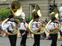 Tuba Players at the Parade. Photo of tuba players at the memorial day parade on constitution avenue in washington dc on 5/30/16. There were many marching bands royalty free stock image