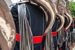Tuba players seen on the back Stock Image