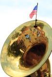 Tuba Reflections och USA flagga Arkivbild