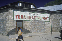 Tuba Trading Post sign painted on adobe brick wall of building Stock Photos