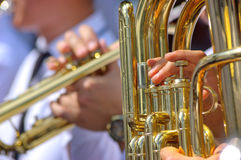 Tuba and trumpet in brass band. Close up view of the brass band stock image