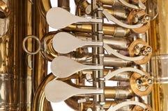 Tuba Valves. Detail view of valve section of vintage tuba Stock Photos